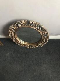 Gold frame round mirror