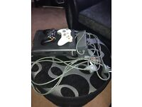 120GB Xbox 360 with 2 controllers with 18 games