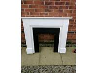 Wooden fire surround with base