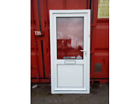White upvc door with clear glass in the top panel,..