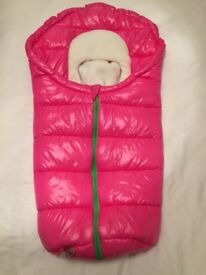Bright pink newborn pram sleeping bag.