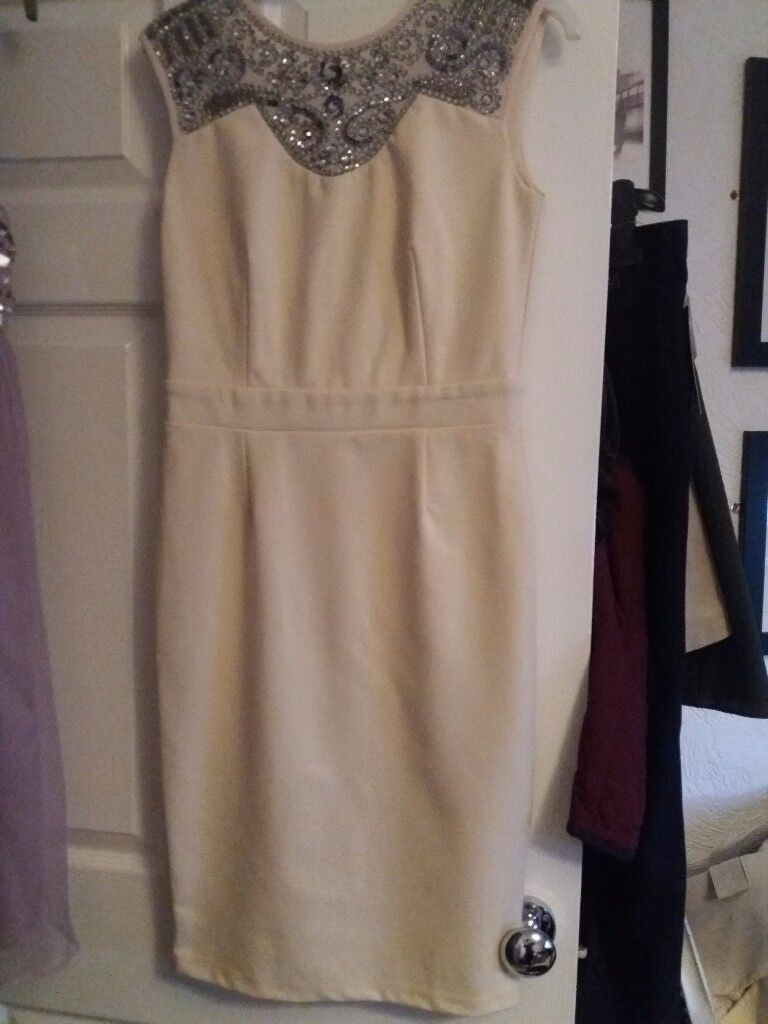 Ladies dresses both new with labels never worn £10 FOR BOTH.