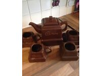 Cadbury's Tea pot and 4 matching chocolate chunk mugs