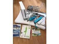 Nintendo Wii Console + Wii Fit Board, Controllers and Games