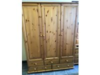 PINE WARDROBE 3 DOORS 5 DRAWERS AND HANGING RAIL VERY GOOD CONDITION, MEASURES 53 INCHES WIDE X 21 I