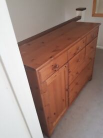 Pine large chest of drawers with cupboard and 8 drawers.