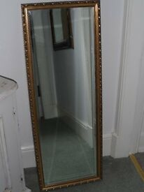 Tall gold coloured Mirror