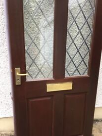 Exterior wooden door, painted with sadolin, double-glazed leaded window, with lock and keys.
