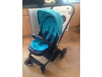 Oyster pram with carry cot and seat unit 2 colour packs black and aqua blue, forward and rear facing