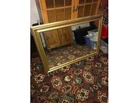 Large gold framed heavy mirror