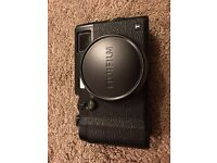 As new Fuji X100T in black with genuine Fuji leather case.