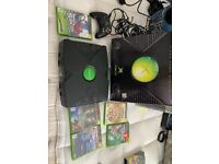 X box console boxed with games and controller in very good condition