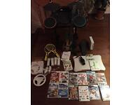 Wii console + wii fit + guitar+ drums + wheel+ rackets + games