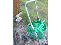 UNWANTED HOSE AND REEL (ONLY £5)