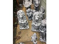 Pair of stone lions garden ornament 16 inches high each