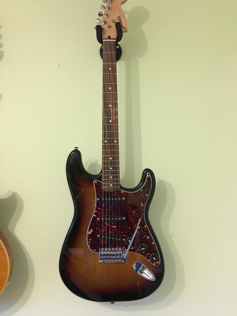 Electric GUITAR - upgraded Squier Stratocaster with Fender headstock logo.