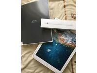 iPad Pro 12.9 inch 64GB with Apple Pencil and official case, unlocked.