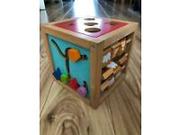 Small wooden activity cube for babies and toddlers
