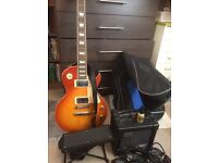 Chord legend, solid mahogany Gibson style guitar with amp and accessories