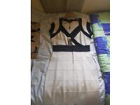 Star. cream and black dress
