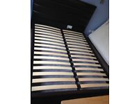 Dark brown kingsize faux leather bed