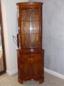 Pretty Walnut corner display cabinet