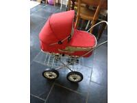 Limited edition red Brio dolls pram