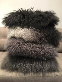 4 real sheepskin Mongolian cushions for only £25 each!