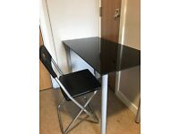 Convenient table with 2 chairs for sale. Perfect for student studios and flats.
