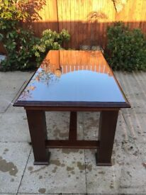 Extending Wooden dining table with glass top
