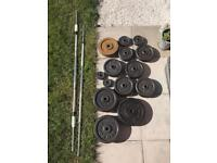 137kg of cast iron weights plus 2 barbells