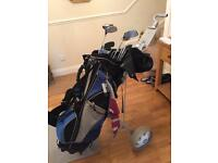 Set of golf clubs, bag, trolley and more