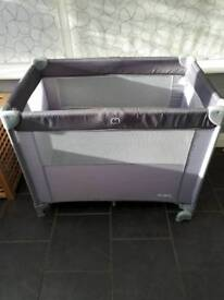 Cot bed with bassinet
