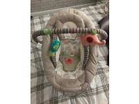 Comfort and harmony baby bouncer