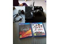 Barely used PS4, 2 wireless controllers and 2 games