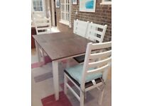 Table and 4 chairs kitchen/dining