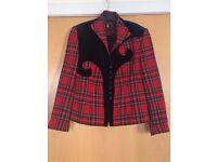 Red Scottish tartan and black velvet jacket by Dutch designer Edgar Vos.