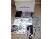 UNUSED Black Nintendo Wii with Nintendo Wii Fit+ board and 5 games-COLLECTION ONLY