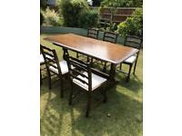 Solid oak dining table and six chairs (can deliver)
