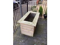 QUALITY WOODEN PLANTERS LOOKING TO BE FILLED WITH SPRING BULBS