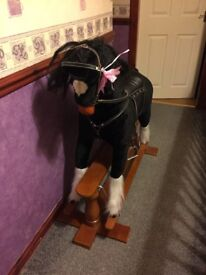 Beautiful rocking horse Maine requires TLC as pictures