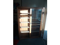 Timber bookcase with adjustable shelves and glazed sliding door