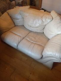 Two double cream leather sofas