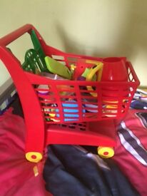 Toy trolley, food and some utensils