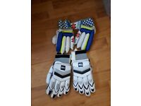 Two pairs of child's left handedcricket gloves, size small and large. Excellent condition.