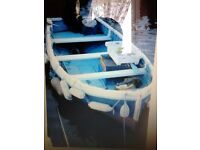 16 and half foot fishing boat on a breakback trailor,