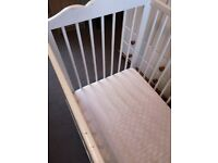 Cot bed with a mattress