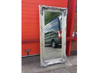 Large silver ornate mirror
