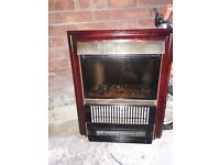 Wooden fire place with tile design and working electric fire