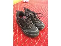 Black and Red unisex Heelys size 3